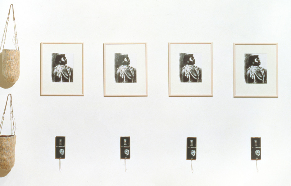 Fiona Foley Givid Women & Mr Fraser, 1992; 4 xerox images of Fraser Island Woman, dilly bags made from paper tissue and string, 4 rat traps; 130 x 200 cm; enquire