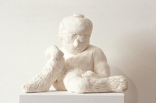 Linda Marrinon Reclining Figure with Boots, 1994; stoneware; 25 cms high; enquire