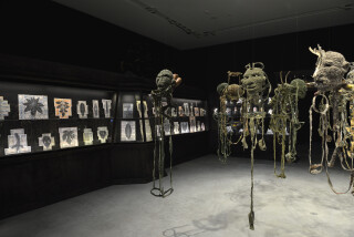 Fiona Hall All the King's Men, 2014-15; knitted military uniforms, animal bone, horn, teeth, dice, glass, leather boxing gloves, pool ball, wire and plastic, 20 parts: ranging from 102 x 58 x 31 cm to 190 x 45 x 42 cm; installation dimensions variable; enquire