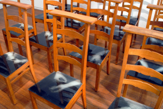 Julie Rrap Julie Rrap, 1990-97; 16 wooden prayer chairs, photo-emulsion on milk glass; dimensions variable; enquire