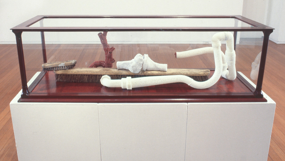 Fiona Hall Dislocation, 1998; PVC plumbing, glass beads, wire, compass, brush & broom head; 38 x 130 x 45 cm; enquire